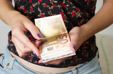 Woman's hands counting euros