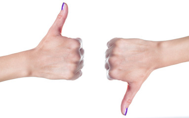 Female hands showing thumbs up and down