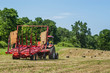 Tractor in Field of Baled Hay