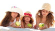 Little girls eating apples