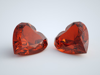Two heart-cut red jewels