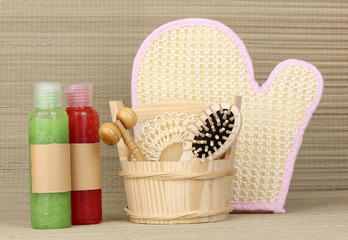 Bathroom set with scrub on bamboo background