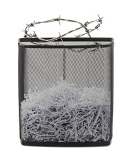 Paper shredder with metal wire basket and bardbed wire, filled w