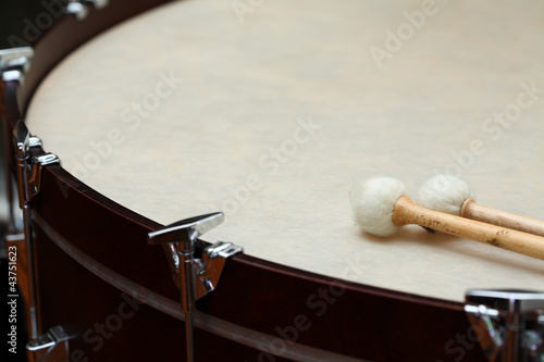 orchestra drum with sticks.