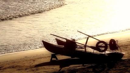 Lifeguard boat on coast at sunset