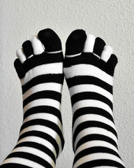 Two feet in stockings black and white striped