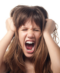 Angry and frustrated teenage girl screaming