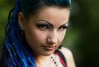 Pierced young girl with blue hair