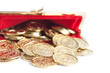 Scattered silver and gold coins are in open red purse, isolated