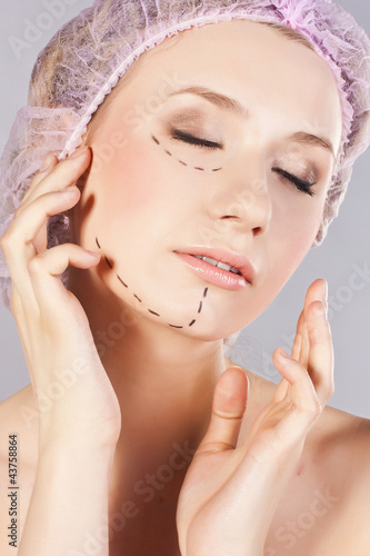 Beautiful young woman, with perforation lines on her face