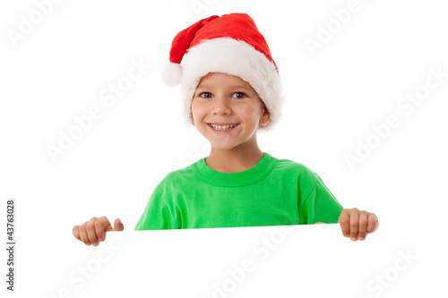 Christmas boy standing with empty blank