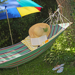 hammock, hat and book in garden