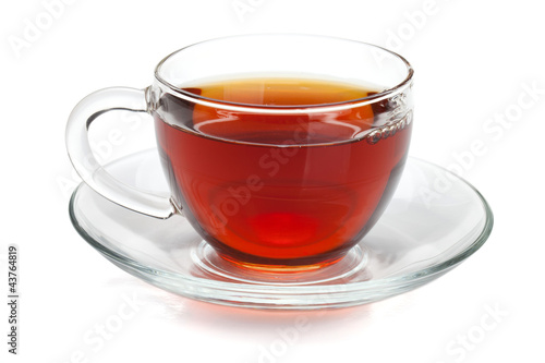 Tuinposter Thee Black tea in glass cup