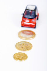 small plastic car with path from euro coins