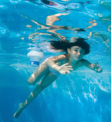 Girl swims and having fun