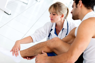 Gym doctor with a patient