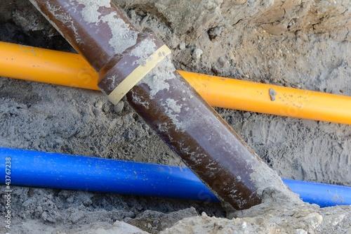 Leinwanddruck Bild Verlegung von Gas-, Wasser- und Abwasserrohren