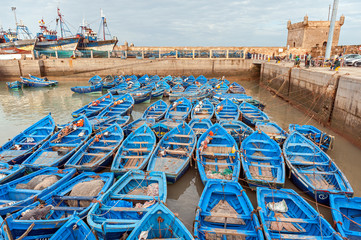 Blue colored fishing boats in moroccan harbor