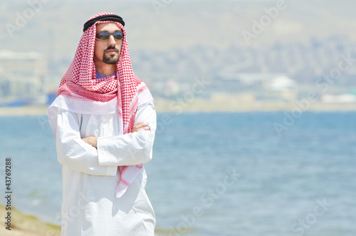 Arab on seaside in traditional clothing