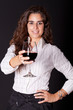 woman holding a glass of wine and smiling