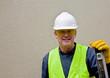 Construction worker leans on spirit level