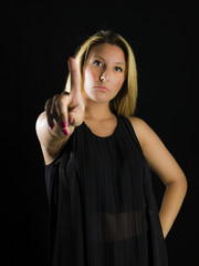 girl with finger up say no color image