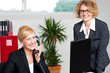 Woman attending call with colleague beside her