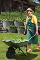 Happy senior working in her garden