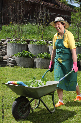 Happy senior working in her garden