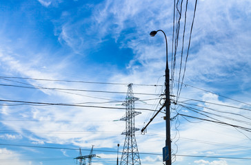 Electric power transmission under white cirrus clouds