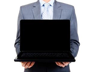 Business man holding blank laptop