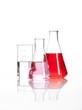 Clear liquid mixed with a red colored chemical reagent, isolated