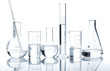 Leinwanddruck Bild - Group of laboratory flasks with a clear liquid, isolated