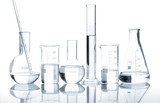 Fototapety Group of laboratory flasks with a clear liquid, isolated