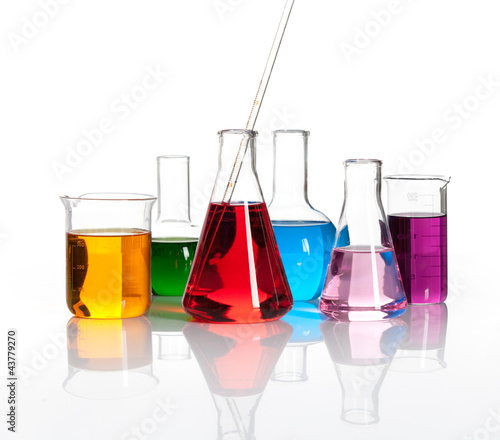 Various laboratory flasks with a colored reagents, isolated