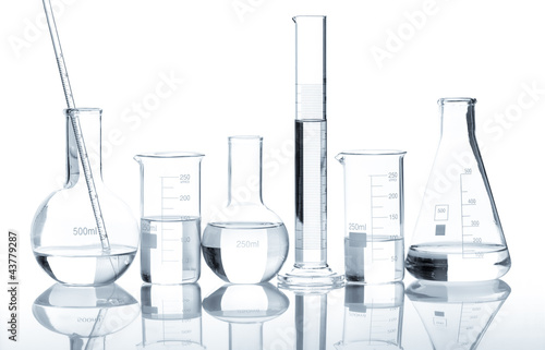 Group of laboratory flasks with a clear liquid, isolated - 43779287