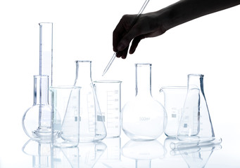 Set of empty laboratory flasks with reflection