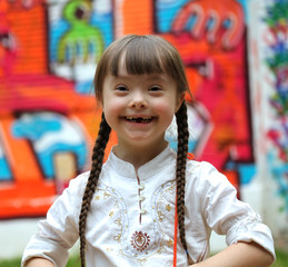 Portrait of beautiful young happy girl on playground.