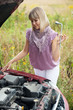 woman trying to fix the car