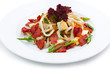 Appetizer salad with ham, greens and roe isolated