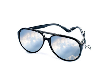 Sunglasses with blue sky shining ray reflection