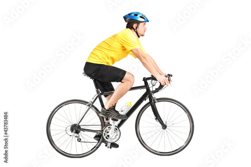 Full length portrait of a man riding a bycicle