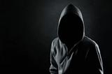 Silhouette of hooded man or hooligan