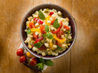 vegetarian couscous with tofu capsicum tomatoes mint and capers