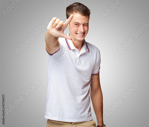 Portrait Of A Handsome Young Man Gesturing