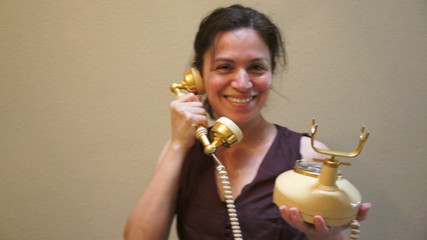 Woman on an Old Retro Style Telephone