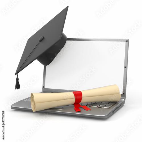 E-learning graduation. Laptop, diploma and mortar board