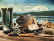 Fly fishing equipment on deck with view of a lake and mountains - 43789818