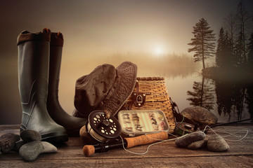 Fly fishing equipment on deck with view of a misty lake