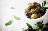 Fototapety Bowl of fresh olives with copyspace